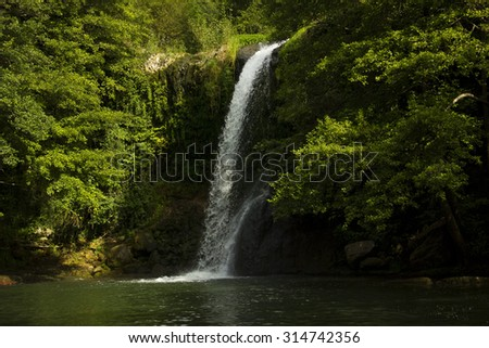 Beautiful waterfall in the rocks. Fresh and clean little river, a relaxing place in the mountain - stock photo