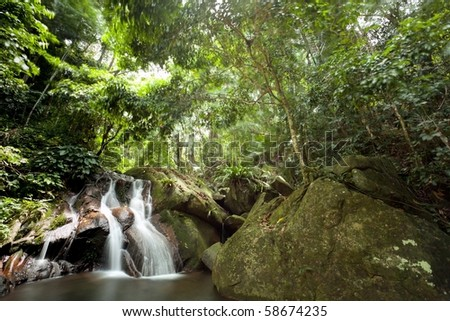 beautiful waterfall in tropical rainforest, Tioman island, Malaysia - stock photo