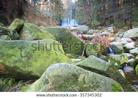 Beautiful waterfall on a mountain slope. River with cascades. - stock photo