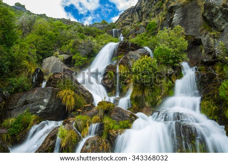 beautiful waterfall on Lower Wye Creek track in Queenstown, New Zealand - stock photo