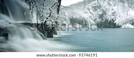 Beautiful waterfalls surrounded with snow