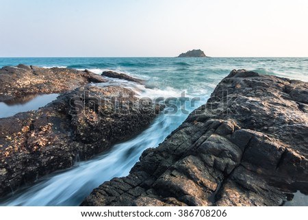 beautiful wave motion when breaking on rock lines. At Rayong a province of Thailand - stock photo