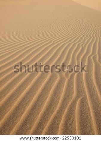 Beautiful wave pattern on desert. - stock photo