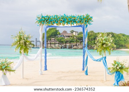 beautiful wedding arch, cabana, beach wedding, tropical wedding set up - stock photo