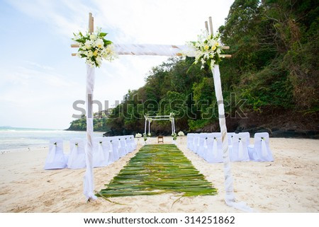 Beautiful wedding arch on the beach in Thailand - stock photo