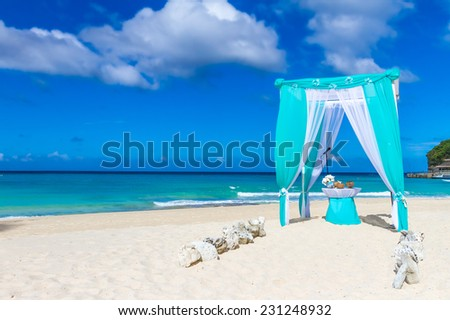 beautiful wedding arch on tropical sand beach, outdoor beach wedding set up - stock photo