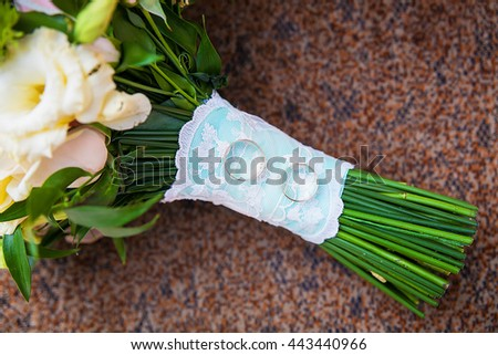 beautiful wedding bouquet and rings close up