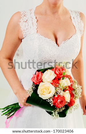 Beautiful wedding bouquet in hands of the bride. Bride with bouquet. bride holds bouquet of roses, closeup