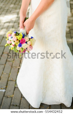 beautiful wedding bouquet of gentle flowers in hands of the bride
