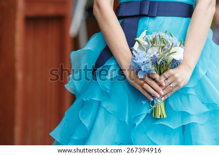 Beautiful wedding bouquet of hydrangea, calla and muscari flowers in hands of the bride - stock photo