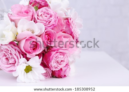 Beautiful wedding bouquet on grey wall background - stock photo