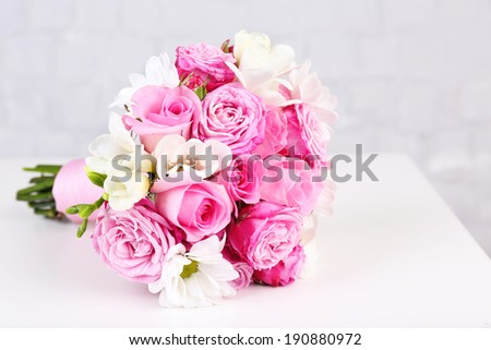 Beautiful wedding bouquet on grey wall background