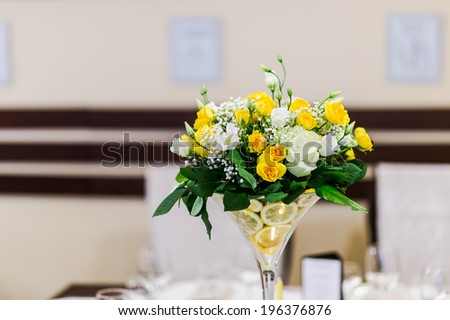 Beautiful wedding bouquet on restaurant table