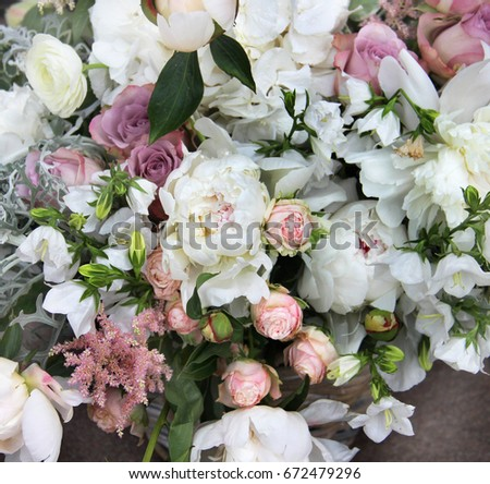 Beautiful wedding bouquet with a lot of tender flowers