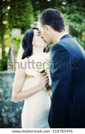 beautiful wedding bride and groom kiss - real people - stock photo