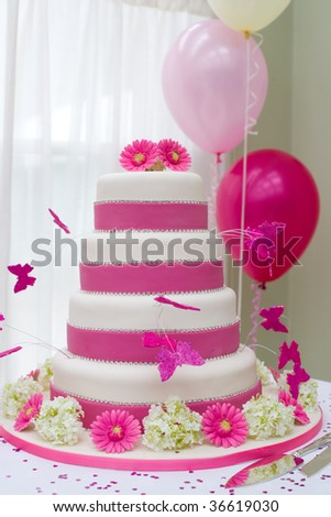 Beautiful wedding cake with butterflies - stock photo
