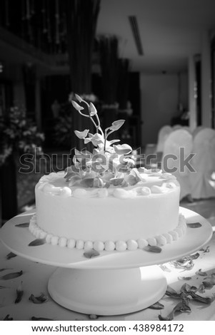 Beautiful Wedding Cake with Orchids on top.(Black and white) - stock photo