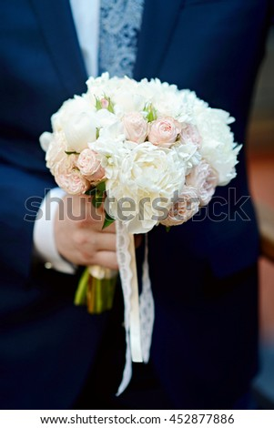 Beautiful wedding colorful bouquet for bride. Beauty of colored flowers. Close-up bunch of florets. Bridal accessories. Female decoration for girl. Details for marriage and for married couple - stock photo