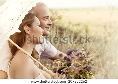 Beautiful wedding couple in the garden  - stock photo