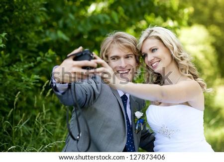 Beautiful wedding couple is enjoying wedding - stock photo