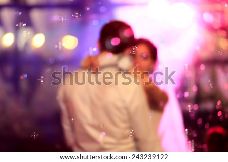 Beautiful wedding dance in soap bubbles,blur - stock photo