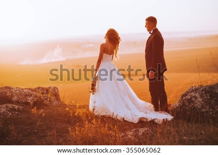 Beautiful wedding day, love on the sunset - stock photo