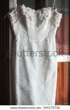 Beautiful Wedding Dress in Room - stock photo