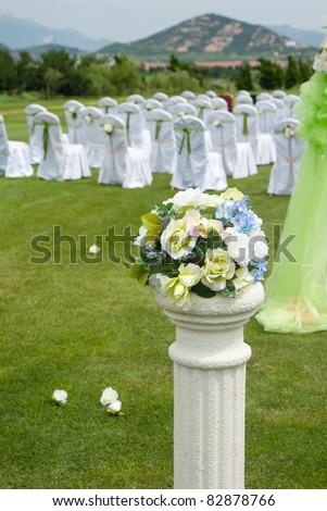 Beautiful wedding flower arrangement of seats along the aisle - stock photo