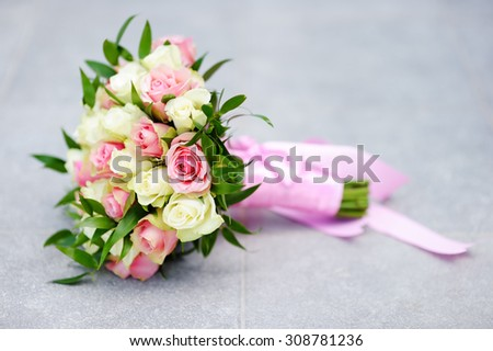 Beautiful wedding flowers bouquet with white and pink roses - stock photo