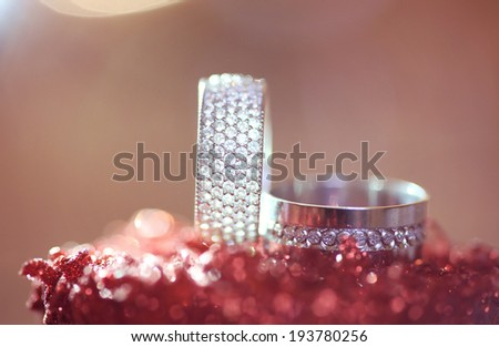 Beautiful wedding rings with crystals - stock photo