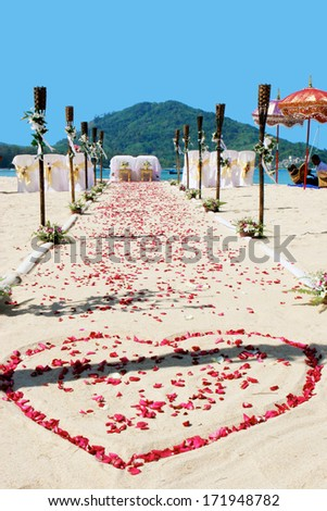 Beautiful wedding set-up on the beach in Bali. - stock photo