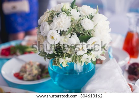 Beautiful wedding table and interior decoration with flowers in blue colors