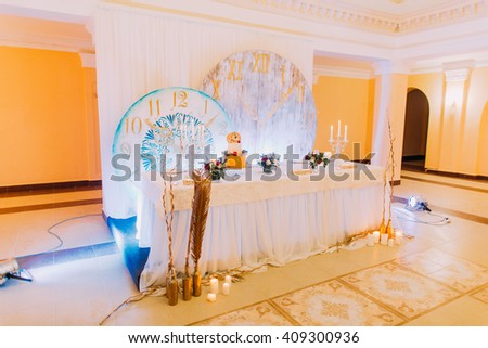 Beautiful wedding table decorated with flowers. Wedding cake. Sweets