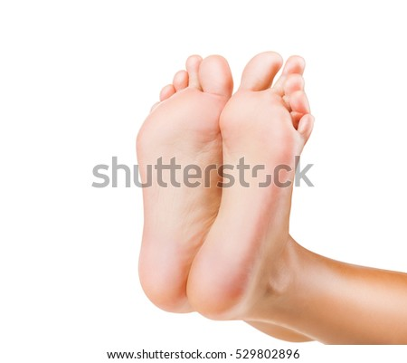 Beautiful well-groomed female a foot and a heel on a white background