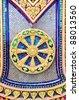 Beautiful wheel of dharma symbol at the base of buddha image - stock photo