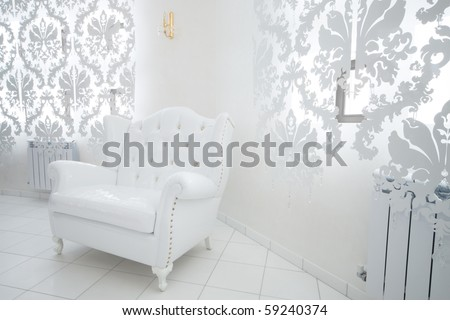 beautiful white armchair in a modern apartment - stock photo