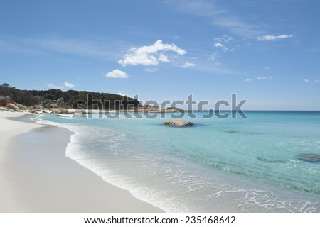 Beautiful white beach with turquoise clear water of Pacific Ocean at Bay of Fires near St Helens, popular holiday destination, copy space. - stock photo