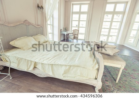 beautiful white bright clean interior bedroom in luxurious baroque style.