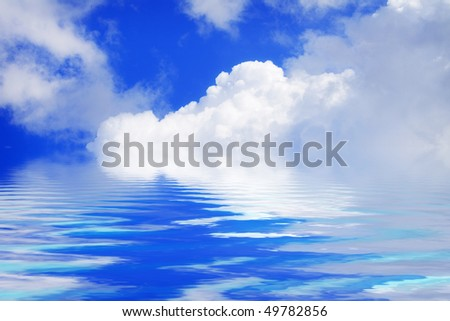 Beautiful white clouds and blue sky on a sunny day with water reflection - stock photo