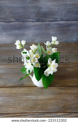 Beautiful white flowers in a vase, sambac
