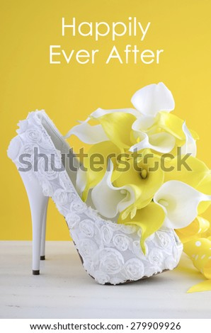 Beautiful white high heel shoe on white shabby chic table with Happily Ever After text,  - stock photo