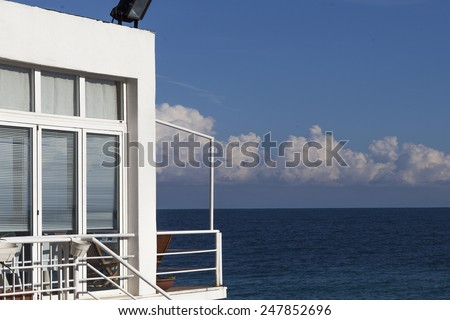 beautiful white residence on the sea - stock photo