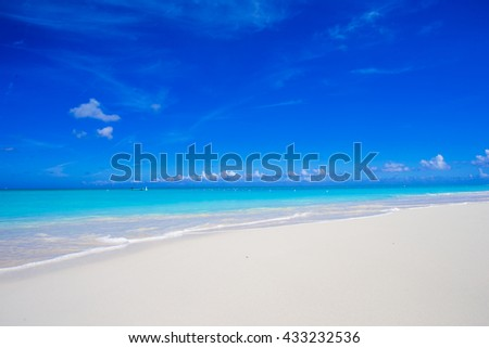 Beautiful white sand beach and turquoise clean water on tropical exotic island - stock photo