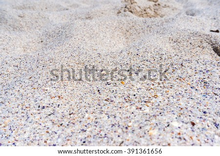 Beautiful white sand texture with small blue pieces of shellfish. Sand dunes. Summer sand background texture. White sand of Jervis Bay, Australia. Selective focus, shallow dof - stock photo