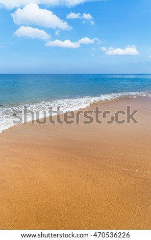 Beautiful white soft wave on empty tropical beach and blue sea.