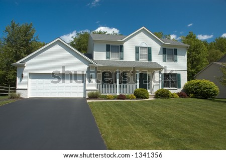 Beautiful white two story new home. Typical home in the suburbs. Just one of many home or house photos in my gallery. - stock photo