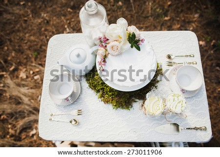 beautiful white wedding cake on white table. wedding party. outdoors reception. dessert. wedding traditions. - stock photo