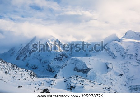 Beautiful wide snow panoramic view of Monte Rosa, mountain massif in the eastern part of the Pennine Alps, between Switzerland and Italy, with peaks Dufourspitze and Lyskamm, near Matterhorn Mountain