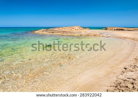 Beautiful wild beach with clear turquoise water. Malia beach, Crete island, Greece.  - stock photo