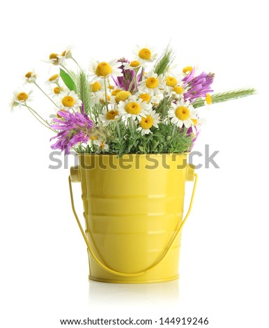 bouquet of wild flowers in a bucket stock images royalty